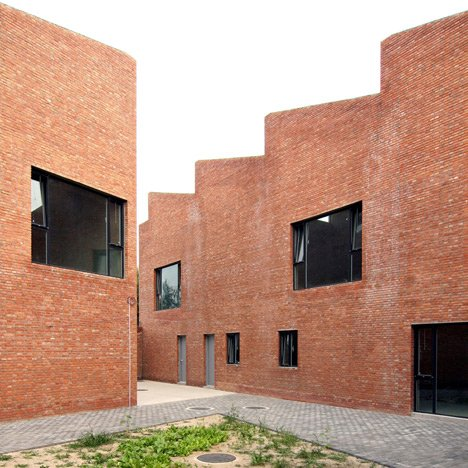 Knowspace builds brick artists' studios and homes around a communal courtyard
