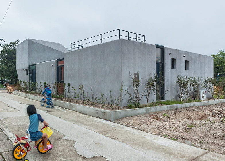 Concrete Voidwall house by AND is punctured by glazed incisions