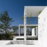 Rectangular arches frame rooms and gardens at Cosmic House by UID Architects