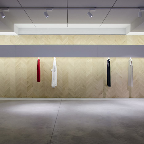 Dori concept store by Archiplan Studio features a herringbone wall