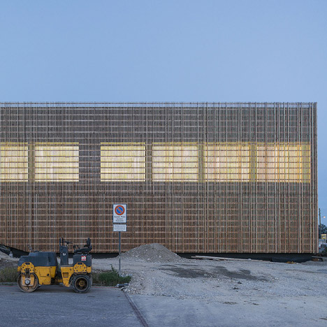 Swiss school extension by Zwimpfer and BBK fronted by slender wooden battens
