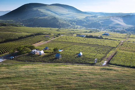 Earthy cabins hide amongst the vineyards<br /> at the Almagyar Wine Terrace in Hungary by by Péter Gereben and Balázs Marián