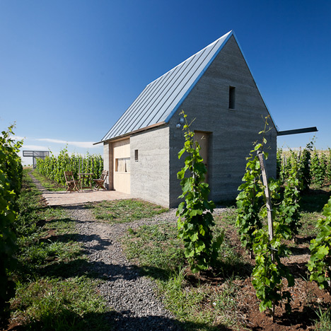 Earthy cabins hide amongst the vineyards at the Almagyar Wine Terrace in Hungary by by Péter Gereben and Balázs Marián