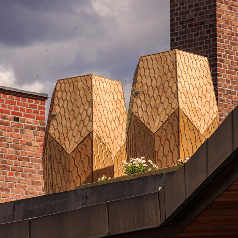 Snøhetta entices bees into Oslo with honey-coloured Vulkan Beehives