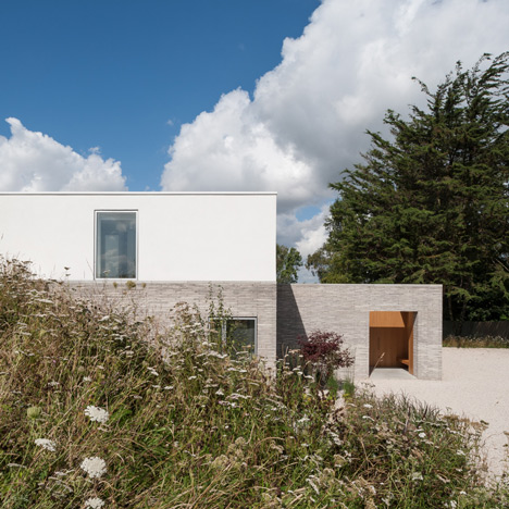 "Broombank house by Soup Architects planned as ""two white sugar cubes"" floating over a meadow"