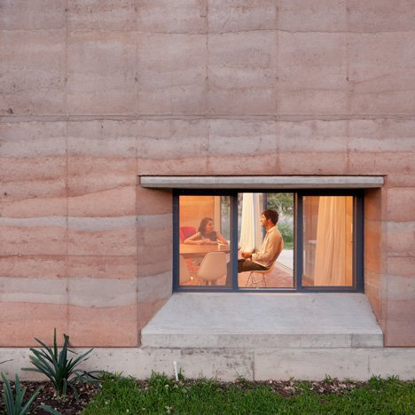 Rammed earth walls with striated patterns<br /> frame Tatiana Bilbao's Ajijic House