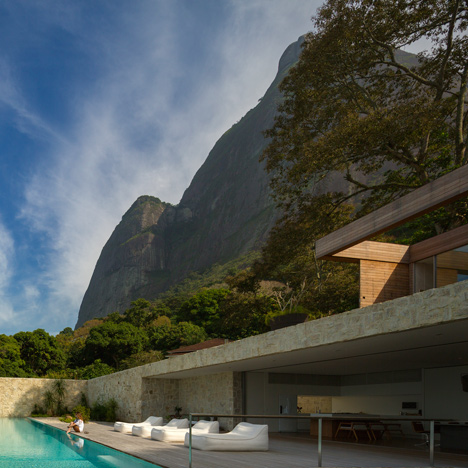 Casa AL by Studio Arthur Casas sits between a mountain and the ocean