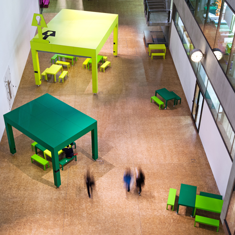 Giant tables by Featherstone Young Architects form workspaces at Central Saint Martins