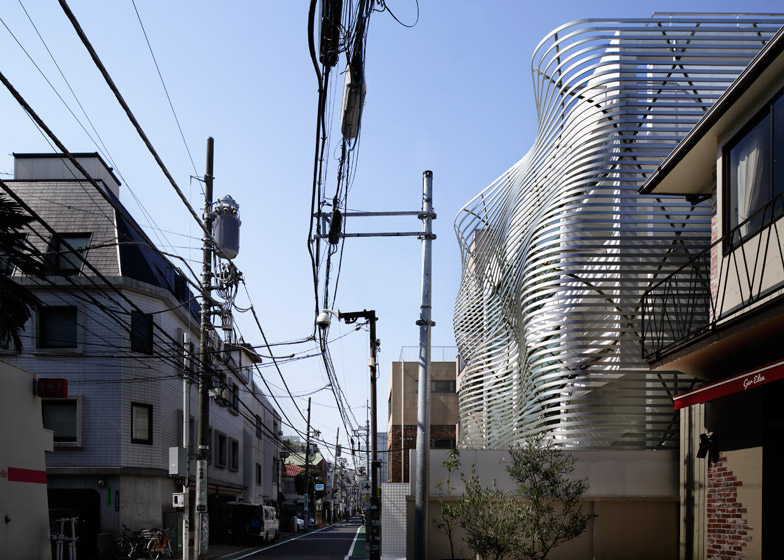 Amano Design Office wraps Tokyo office block with steel ribbons