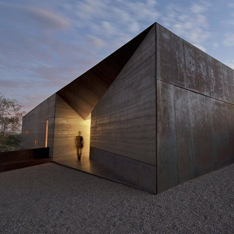 Desert Courtyard House by Wendell Burnette features rammed earth walls
