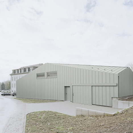 A faceted roof conceals the size of Hangar XS warehouse by Ecker Architekten