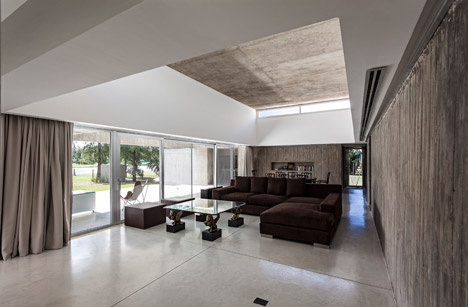 Air Conditioning Has Been Concealed Within The Upper Walls Around Living And Dining Room While Clerestory Windows Have Added At Either End To