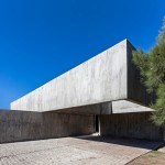 Stacked concrete volumes frame entrance to House M by Estudio Aire