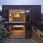 Offset timber volumes create courtyards at House in Komae by Architect Cafe