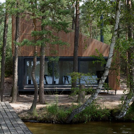 FAM Architekti's Lake Cabin provides a waterside retreat in a Czech forest