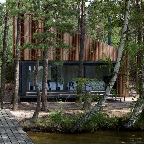 FAM Architekti's Lake Cabin provides a waterside retreat in a Czech forest