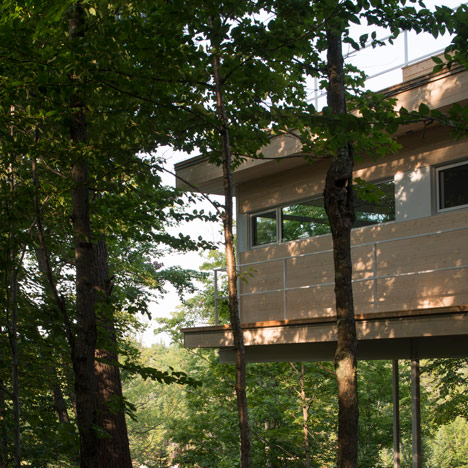 Atelier Pierre Thibault's Le Grand Plateau house is raised on stilts above a forest floor