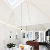 Faceted ceilings direct sunlight into Sydney home by Carter Williamson Architects