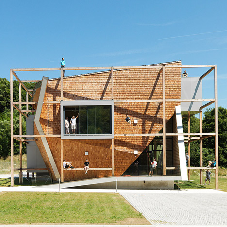 Timber frame surrounding Heri & Salli's Office Off transforms the building into a climbing frame