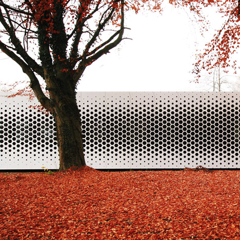 Honeycomb perforations speckle facade of Campus Netzwerk office by Format Elf Architekten