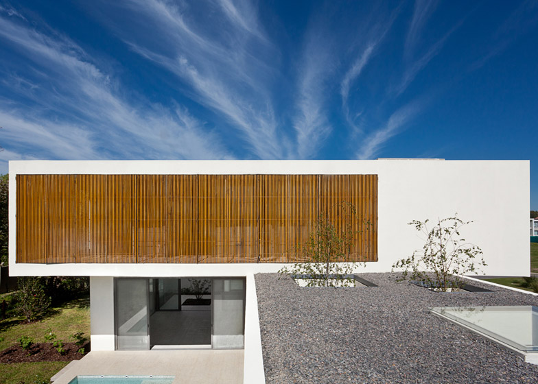 Timber screens bring fresh air into Pedro House without compromising privacy