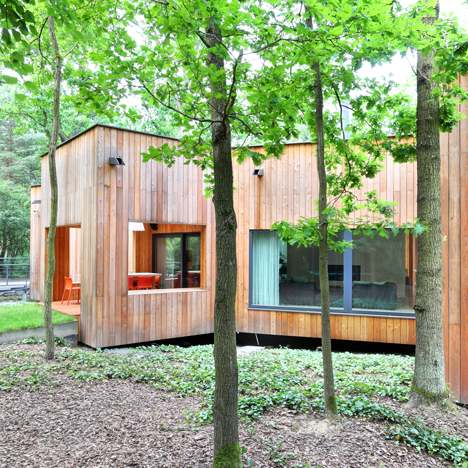 Jakub Szczęsny configures Podkowa House to fit around trees in a Polish forest