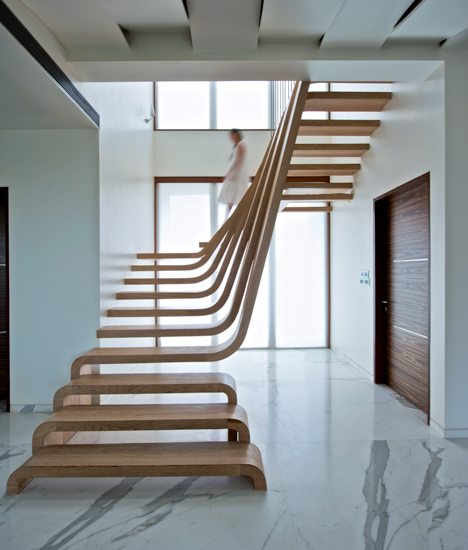 Big Walnut Apartments: Waves Of Wood Form Staircase By Arquitectura En Movimiento