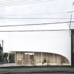 Kohki Hiranuma's Osaka dental surgery features curvy corners and a twisted roof