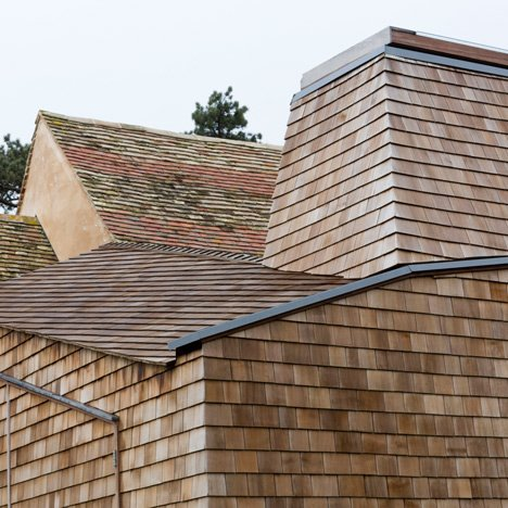 Wildfowl Cottage extension by 5th Studio is clad with shingles and raised over a flood plain