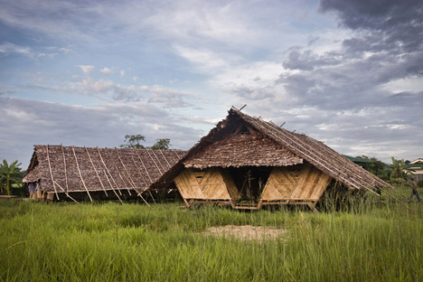 Teak and bamboo structures accommodate Burmese refugees in a Thai village