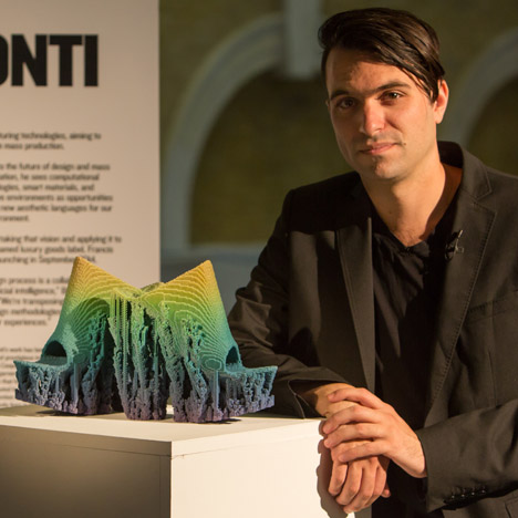 Francis Bitonti with his pair of shoes that were 3D-printed with gradients of colour