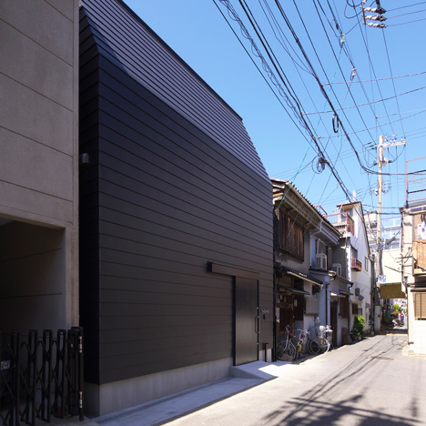 Black house in Osaka by Coo Planning features a basic plywood interior