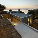 House in Kea is a concrete residence built around oak trees on a Greek isle