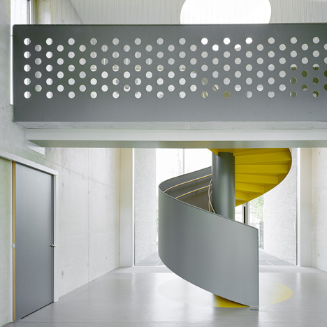 Kindergarten by Ecker Architekten features an austere colour palette and a spiral staircase