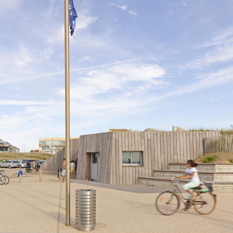 THE Architectes conceals nautical sports base under a grassy beach dune