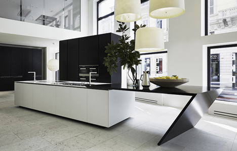 The Sharp kitchen of Poliform Varenna designed by Daniel Libeskind, uses DuPont Corian high-tech surface in the Glacier White colour for the worktop and the sink.