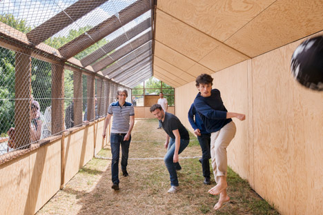 "Guinée*Potin Architectes creates ""footcheball"" playground inside a thatched shed"