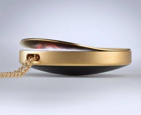 Purple locket by Artefact