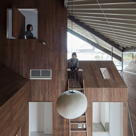 Y+M Design Office envelops seven blocks under one roof with Rain Shelter House