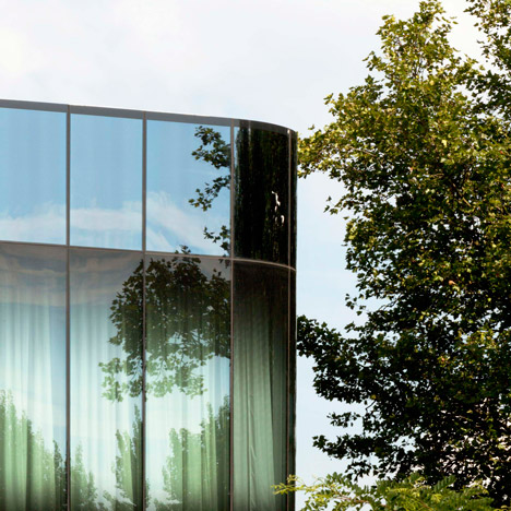 Rounded glass facades improve views from Wiel Arets' water-traffic control centre
