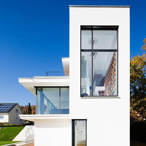 Philipp Architekten's all-white House M frames a sunken pool