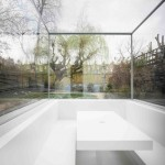 "Gianni Botsford sinks ""invisible"" extension into the garden of a London house"