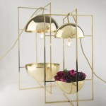 MEJD Studio slices traditional objects in half to create contemporary lighting