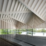 Angular wooden roof reduces sound reverberation inside swimming pool by Duggan Morris