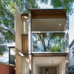 Giant sash windows cover the back of Panovscott's Sydney house extension