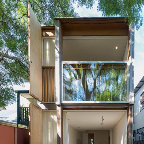 Giant sash windows cover the back of Panovscott's Sydney house extension