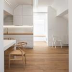 Arhitektura d.o.o. renovates cross-shaped attic in Slovenia into holiday home