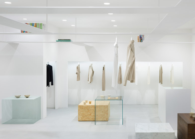 Nendo creates vertical layers in beige fashion boutique for Minimalist architecture theory