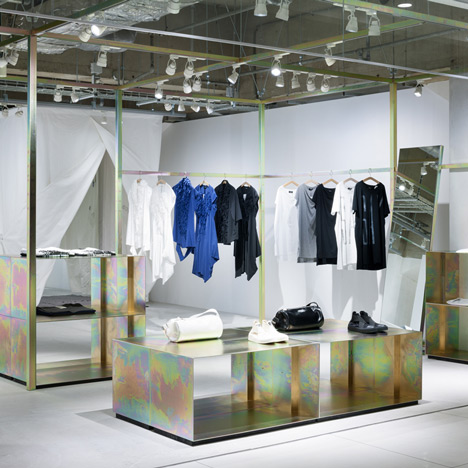 Schemata Architects refits Japanese clothing store with petrol-hued display structure