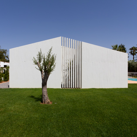 Atelier Data adds concrete volumes and internal courtyards to Algarve house